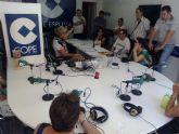 Usuarios del Centro de D�a para Personas con Enfermedad Mental visitan los estudios de la emisora 'Cadena COPE' en Totana