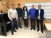 La Agrupación Musical de Totana firma un acuerdo de colaboración con la Hermandad de Santa María Magdalena para participar en la Semana Santa de Totana