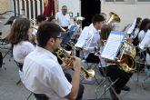 La banda de música hace parada en el barrio del Carmen para celebrar el 700° aniversario como mayorazgo del municipio