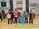 Numerosas personas participan en 'Solidarios por los pelos', celebrada en Alhama de Murcia a beneficio de D´Genes y la Fundación Francisco Munuera