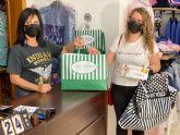 La ganadora de 1.000 euros en la campana 'un premio por mamá' realiza sus compras