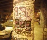 Inicio de la pegada de carteles con motivo de la convocatoria de huelga feminista para el 8 y 9 de marzo en la Región de Murcia