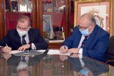 El decano del Colegio de Abogados de Sevilla, Óscar Cisneros Marco, firma un convenio de colaboración con el Ateneo de Triana
