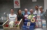 Entrega de alimentos de la Cofradía de San Ginés de la Jara al Comedor Caritas