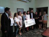 La Cofradía de San Ginés de la Jara hizo entrega del dinero recaudado por los rollos de San Ginés a las Damas del Carmen