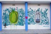 La plaza de abastos del Puerto y el pabell�n de la Cañadica muestran dos murales urbanos del artista Sebas hH