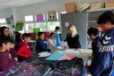 Los vocales infantiles del Consejo Municipal de Infancia y Adolescencia visitan la sede de la asociación ASIDO