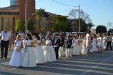 Los niños de comunión procesionan con motivo del Corpus Christi