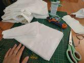 La Junta Vecinal de Perín organiza a colectivos locales para fabricar mascarillas